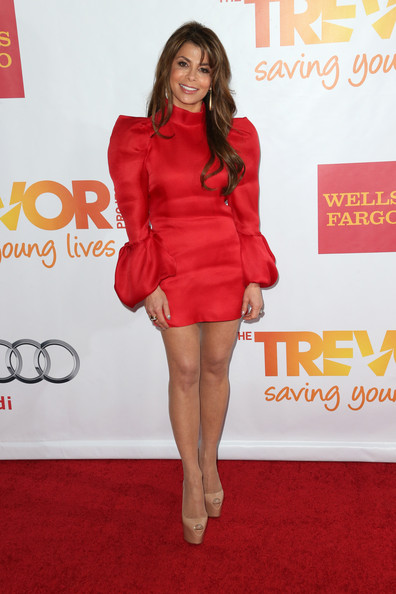 Paula Abdul cut a stark figure in a red mini dress with pointy shoulders and blouson sleeves during TrevorLIVE.