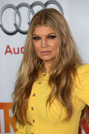 Fergie stuck to her customary long center-parted waves when she attended TrevorLIVE.