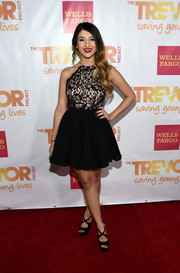 Mia Pfirrman looked cute in a fit-and-flare halter dress during the TrevorLIVE LA event.