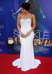 "Jordin Sparks made sure every bit of her red-carpet look sparkled as much as her smile at last night's ""Sparkle"" premiere—her shimmery silver clutch included."