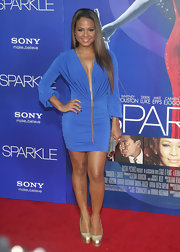 Christina Milian stole the show at the 'Sparkle' premiere in this saucy blue knit dress.