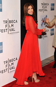 Eva Mendes teamed her vibrant red Gucci dress with tan patent Louisa platforms with double crisscross straps.