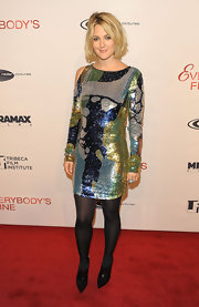Drew sparkled in a blue-green Spring 2010 sequined dress. The fun mini dress featured an interesting cutout shoulder and long sleeves.