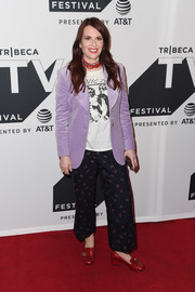 Megan Mullally dressed up a graphic tee with a lavender velvet blazer for the Tribeca TV Festival celebration for 'Will & Grace.'