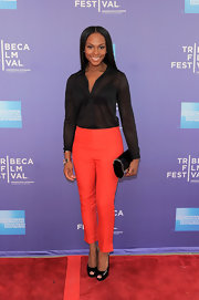 Tika Sumpter teamed a black button-down, bright pants, and peep-toes for her Tribeca Film Festival red carpet look.