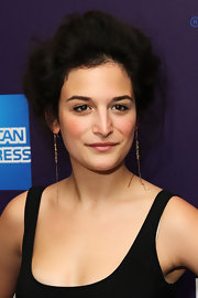 Jenny Slate showed off her messy hairdo while hitting the Tribeca Film Festival. She kept her look soft by not adding a lot of hair product.