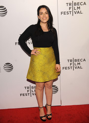 Abbi Jacobson brightened up her look with a gold A-line mini skirt.