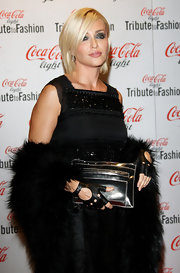 Paola Barale's structured metallic silver clutch and ultra-feminine LBD were a winning combination.