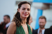 Berenice Bejo styled her hair into a half-up 'do with curly ends for the Deauville American Film Festival premiere of 'Good Time.'