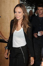 Olivia layered her sleeveless white U Tank with a sheer black blazer.