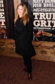 Holly Hunter opted for a masculine look in a pair of brown leather loafers.