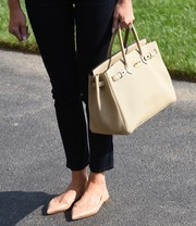 Melania Trump matched pointy nude Louboutin flats with an Hermes Birkin for her trip back to the White House from Camp David.