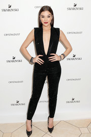 Hailee Steinfeld took a bold plunge in a sparkly black jumpsuit with a down-to-the-navel neckline for the Swarovski meet-and-greet.