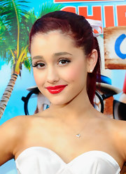 Ariana Grande swept on shiny cherry lipstick for the 'Alvin and the Chipmunks: Chipwrecked' DVD release party.