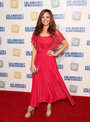 Rachel Boston stunned in a hot pink pleated frock that featured a lace overlay on the bodice and shoulders.