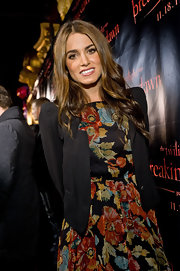 Nikki Reed layered a black bold-shouldered blazer of her flirty Topshop frock at the 'The Twilight Saga: Breaking Dawn' concert tour.