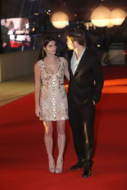Ashley Greene shined on the red carpet at the Brussels premiere of 'Breaking Dawn.' She finished off her look with nude platform pumps.