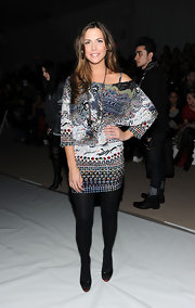 Erin wears an off-the-shoulder abstract digital print knit dress for the Wenlan fashion show.