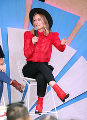 A pair of red ankle boots with metal toe caps completed Olivia Wilde's outfit.