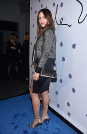 Katharine McPhee accessorized with an elegant satin envelope bag with a gold chain strap at the Tyler Ellis 5th anniversary celebration.