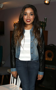 Dionne Bromfield attended a Tyler James showcase in a stylish denim and leather jacket.