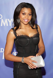 Taraji P. Henson wore a bustier dress from Dolce & Gabbana and her hoop earrings add a fierce touch of glam to her sexy dress.