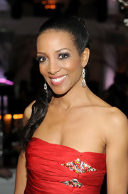 Shaun Robinson upped the glamour of her stunning red gown with a pair of diamond drop earrings.