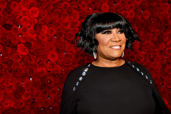 Patti LaBelle attended the Tyler Perry Studios grand opening wearing a short wavy cut with blunt bangs.
