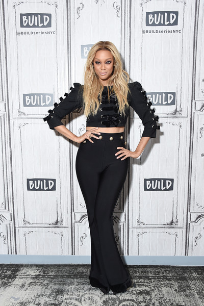 Tyra Banks High-Waisted Pants [americas next top model,flooring,fashion model,fashion,outerwear,formal wear,leg,long hair,carpet,suit,jeans,celebrities,tyra banks,model,tv personality,build studio,new york city]