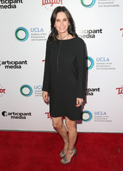 Courteney Cox styled her simple LBD with gray ankle-strap heels.