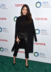 Eiza Gonzalez capped off her all-black look with a wool coat.