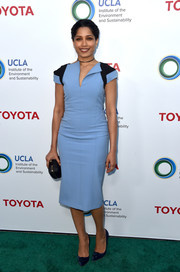Freida Pinto chose a structured blue and black midi dress by Amanda Wakeley for the Innovators for a Healthy Planet event.