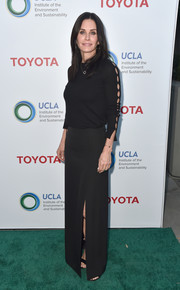 Courteney Cox kept it minimal in a black sweater with sleeve cutouts at the Innovators for a Healthy Planet event.