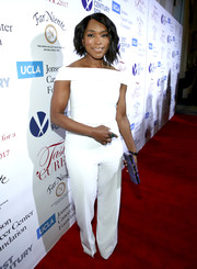Angela Bassett looked smart in a white off-the-shoulder jumpsuit by Christian Siriano at the Taste for a Cure event.