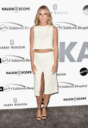 Gwyneth Paltrow pulled her outfit together with a pair of black slim-strap sandals by Jimmy Choo.