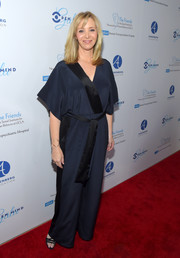 Lisa Kudrow attended the Open Mind Gala wearing a kimono-inspired midnight-blue jumpsuit with black trim.