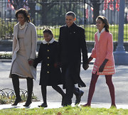 Malia Obama looked adorable in a retro pink wool coat with cropped sleeves and white print trim.