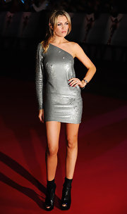 Abbey Clancy looked futuristic at the premiere of 'This is It' in a silver one-shoulder dress and platform boots.