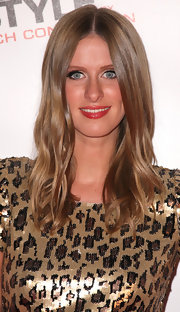 Nicky Hilton wore her long wavy locks down in a center part hairstyle.