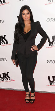 Kim opted for a strong-shouldered black blazer at the UK Style premiere.