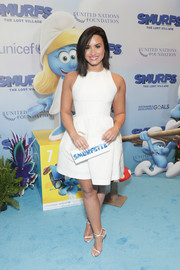 Demi Lovato complemented her dress with strappy white heels by Giuseppe Zanotti.