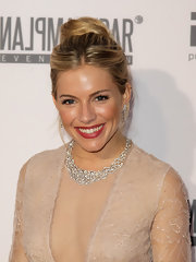 Sienna Miller amped up the luxe factor with a diamond statement necklace and matching earrings.
