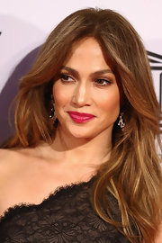 We loved the pop of color JLo gave to her look with this cranberry lip tint.