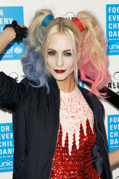 Poppy Delevingne rocked blue-and-pink-tinged pigtails for her Harley Quinn-inspired look during the UNICEF Halloween Ball.