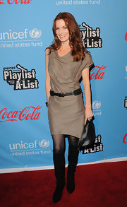 Laura Leighton wore this draped cocktail dress with fishnet tights and knee-high boots.
