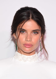 Sara Sampaio attended the UNITAS Gala Against Human Trafficking wearing her hair in a loose center-parted chignon.
