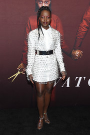 Lupita Nyong'o rocked a white Balmain shirtdress with a spiked PVC overlay at the New York premiere of 'Us.'