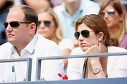 Mirka Federer's pink-faced watch was a pretty accessory for her wrist.