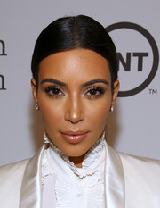 Kim Kardashian pulled her locks back into a tight center-parted ponytail for the USC Shoah Foundation anniversary gala.
