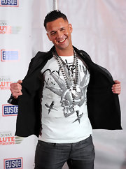 The Situation paired his printed T-shirt with a beaded necklace complete with a cross pendant.